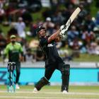 New Zealand's Colin de Grandhomme hits a six on his way to 74 not out against Pakistan at Seddon...
