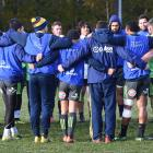 The Highlanders squad huddle at the start of their Thursday morning training session. Photo:...
