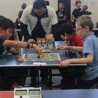 Ethan Tamariki (11, left) does battle with Tyrone McLeod (9) during the New Zealand Chess...