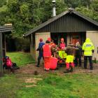 Some of the 18 people who helped in the weekend search at Lake Hauroko gather outside Teal Bay...