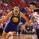 Klay Thompson (left) takes the ball to the hoop against Danny Green on Monday during game two of...