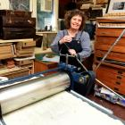 Lynn Taylor in her Lighthouse Studio in Portobello with her largest press, with which she uses...