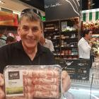 Silver Fern Farms Co-operative chairman Richard Young holds Silver Fern Farms branded lamb hot...