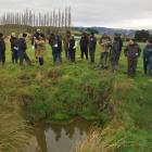 Visitors to a Waikoikoi water quality trial site last week inspect a sediment trap successfully...