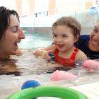 Lillie Harding (almost 3) gets a lesson from instructor Megan Taylor (right) yesterday, assisted...