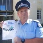 Senior Sergeant Jason McCoy, of Oamaru, with a home security questionnaire being handed out to...