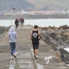 Visitors stroll along Oamaru's historic breakwater last year. The Waitaki District Council...