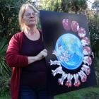 Oamaru woman Trish Shirley with the logo she created called 'One Last Bite' for her new Oamaru...