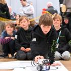 Wanaka Primary School pupil Jacob Gould (10) makes an adjustment to the robot built by fellow...