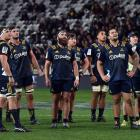 Highlanders players look up at a big screen  to see if   they have scored  against  the Bulls in...
