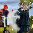 Green Island School pupils Willow Kenny and Tristen Pickering (both 9) play with the Poppazoid...