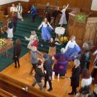 People express their love of movement at Shona MacTavish's funeral at Knox Church yesterday....