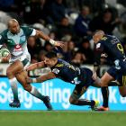 Cornal Hendricks of the Bulls is tackled by Sio Tomkinson during the Highlanders' match at...