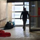 Fast asleep, wrapped tightly in blankets in the entrance to the Westpac building in George St,...