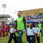 Faf Du Plessis leads South Africa on to the field for their ultimately washed out World Cup match...