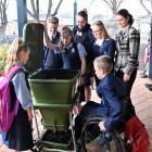 Taieri College envirogroup members inspecting one of their worm farms at the school are ...