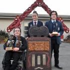 Displaying their well-earned trophies are three of the nga toa whakaihu waka o Nga Manu Korero...