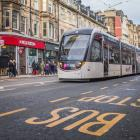 An electric tram glides through central Edinburgh. Photo: Getty Images