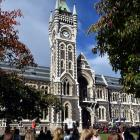 People gather on the University of Otago clocktower lawn for the OUSA Anzac Service in Dunedin....