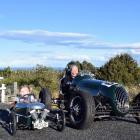 Jim Bennett and his great-granddaughter Arnikah Burke (3), of Dunedin, in an Impulse racing car...