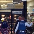 Police at Sue Todd Antiques following a robbery at the store last week. Photo ODT