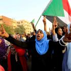 Sudanese protesters march during a demonstration to commemorate 40 days since the sit-in massacre...