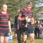 Arrowtown's Jackson Wallace (left) and Malcolm Sutherland begin celebrations as they lift the...