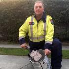 Disposing of some ashes is Alexandra Fire Brigade Senior Station Officer Mark Donald. Photo: Adam...
