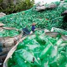 Vietnamese women work with recyclable plastic bottles at Xa Cau village, outside Hanoi. Photo:...
