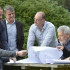 Looking at plans of the Ashburn Clinic expansion are (from left) project manager David Booth and...