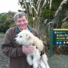 "Kaka Point resident Lyall Butterfield, holding Misha, says the ""urban'' definition of the town in..."