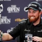 Republic of Ireland's Shane Lowry with the Claret Jug trophy in a press conference after winning...