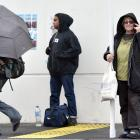 Dunedin resident Anne Marie Parsons (second from right) stands in the rain at Dunedin's regional...