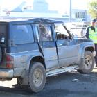 The Land Rover was hit by the school bus on the driver's side and sustained a significant dent....