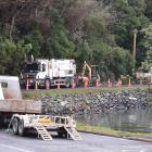 Contractors fix a water leak in Careys Bay on Saturday. PHOTO: GREGOR RICHARDSON