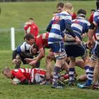 Clutha flanker Kurt Turnbull powers through the tackle of Heriot fullback Clayton Buchanan during...