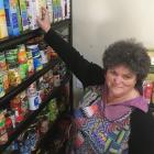 Central Otago Budgeting Services office manager/co-ordinator Pam Hughes handles donations of food...