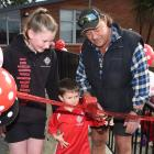 Fairfield school pupils Charly Wood (13) and Declan Wright (5) cut a ribbon with board of...