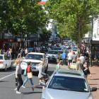 Boxing Day shoppers throng Dunedin at the corner of George and St Andrew Sts last year; local...