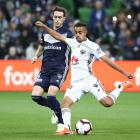 Sarpreet Singh (R) in action for the Phoenix against Melbourne Victory in Melbourne last month....