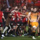 The Crusaders celebrate at the final whistle of their third-straight Super Rugby final victory....
