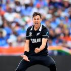 New Zealand's Trent Boult celebrates taking the wicket of India's Virat Kohli lbw during the ICC...