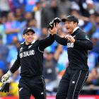 Guptill is congratulated by wicketkeeper Tom Latham. Photo: Getty Images