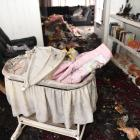 The charred interior of a Green Island home which caught fire early yesterday after hot ashes...