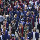 Otago Polytechnic graduands make their way up Moray Place before their graduation ceremonies....