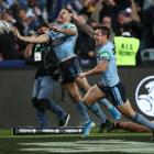 James Tedesco and Mitchell Pearce celebrate the series-winning try. Photo: Getty Images