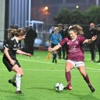 Kate Guildford of Dunedin Tech on the attack against Coastal Spirit's Rebecca Wilson at Logan...