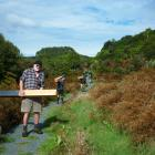 Forest & Bird Southland member Lloyd Esler leads volunteer workers at the Lenz Reserve in the...