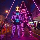 Logan Elliott (left) and Andy Wilkinson, both of Wellington, entertain a large crowd at the Glow...