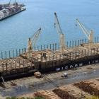 Logs  are loaded  on  Bunun Dynasty at Port Otago's Beach St wharf, Port Chalmers. Photo: Stephen...